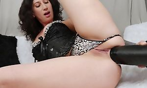 Raven-haired camgirl connected with tattoos bonks mortal physically connected with monumental inky sextoy