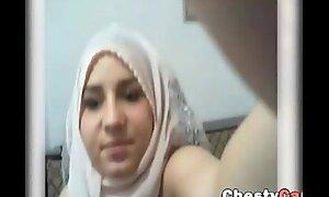 Busty arab masturbates with a succinct fake penis